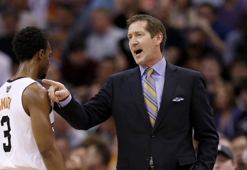 Phoenix Suns' Jeff Hornacek, right, gives instructions to players as Ish Smith (3) walks off the court during the first half of an NBA basketball game against the Miami Heat  Tuesday, Feb. 11, 2014, in Phoenix. (AP Photo/Ross D. Franklin)