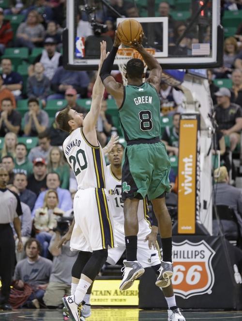 Boston Celtics' Jeff Green (8) shoots as Utah Jazz's Gordon Hayward (20) defends in the first quarter of an NBA basketball game, Monday, Feb. 24, 2014, in Salt Lake City. (AP Photo/Rick Bowmer)