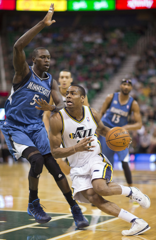 Lennie Mahler  |  The Salt Lake Tribune Utah Jazz guard Alec Burks drives by Timberwolves Center Gorgui Dieng in the first half of a game Saturday, Feb. 22, 2014, in Salt Lake City.