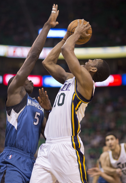 Lennie Mahler  |  The Salt Lake Tribune Utah Jazz guard Alec Burks is fouled on his way to the basket by Timberwolves Center Gorgui Dieng in the first half of a game Saturday, Feb. 22, 2014, in Salt Lake City.