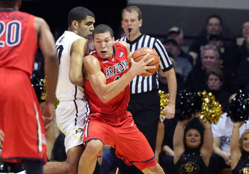 Arizona's Aaron Gordon tries to get around Colorado's Josh Scott during the first half of an NCAA college basketball game, in Boulder, Colo., Saturday, Feb. 22, 2014. (AP Photo/Brennan Linsley)