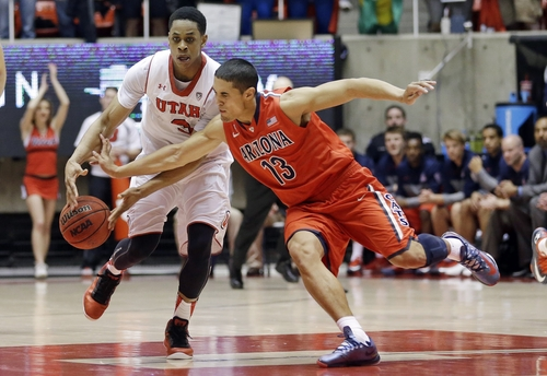 Arizona's Nick Johnson (13) attempts to steal the ball from Utah's Princeton Onwas (3) in the second half of an NCAA college basketball game Wednesday, Feb. 19, 2014, in Salt Lake City. Arizona won 67-63. (AP Photo/Rick Bowmer)