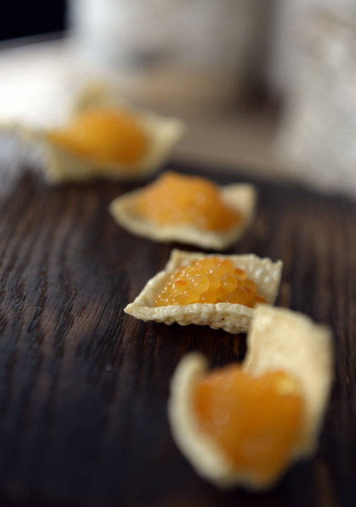 Francisco Kjolseth  |  The Salt Lake Tribune Bowman Brown, the chef and owner of Forage in Salt Lake City, is using fresh caviar harvested from Spring Lake Trout Farm in Payson. Brown uses the orange-colored roe in many different ways, but most recently on a potato cracker with sour cream that accompanies smoked trout.