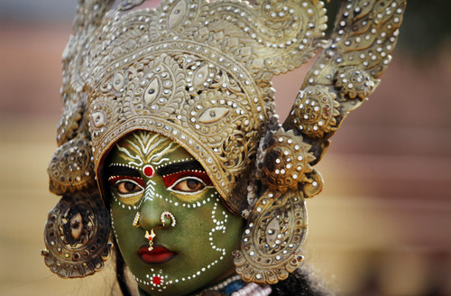 A women dressed as Hindu Goddess Kali participates in a procession on the eve of Shivratri festival, in Jammu, India, Wednesday, Feb. 26, 2014. Shivratri, a festival dedicated to the worship of Hindu God Shiva, will be marked across the country Thursday. (AP Photo/Channi Anand)