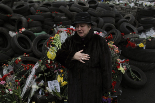 A woman cries at a memorial for the people killed in clashes with the police at Kiev's Independence Square, the epicenter of the country's current unrest, Ukraine, Wednesday, Feb. 26, 2014. Ukraine has been consumed by a three-month-long political crisis. President Viktor Yanukovych and protest leaders signed an agreement last week to end the conflict that left more than 80 people dead in just a few days in Kiev. Shortly after, Yanukovych fled the capital for his powerbase in eastern Ukraine but his exact whereabouts are unknown. (AP Photo/Marko Drobnjakovic)