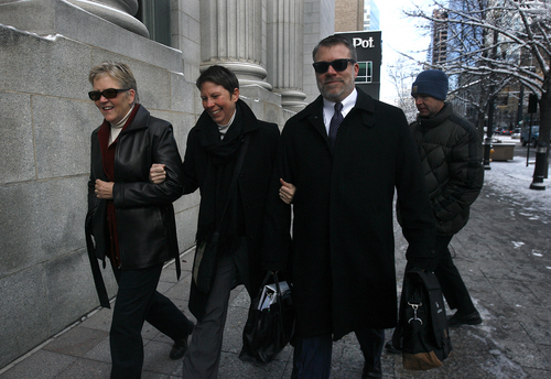 Scott Sommerdorf      The Salt Lake Tribune Laurie Wood, left, and Kody Patridge enter U.S. District Court, Wednesday December 4, 2013. Judge Robert J. Shelby ruled on Dec. 20 that Utah's ban on same-sex marriage is unconstitutional. The man on the right is unidentified.