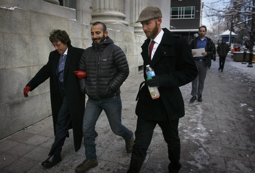 Scott Sommerdorf   |  The Salt Lake Tribune Moudi Sbeity, center, and Derek Kitchen, right, arrive with their attorney Peggy A. Tomsic at U.S. District Court Wednesday morning, Dec. 4, 2013. Judge Robert J. Shelby ruled on Dec. 20 that Utah's ban on same-sex marriage is unconstitutional. The man on the right is unidentified.