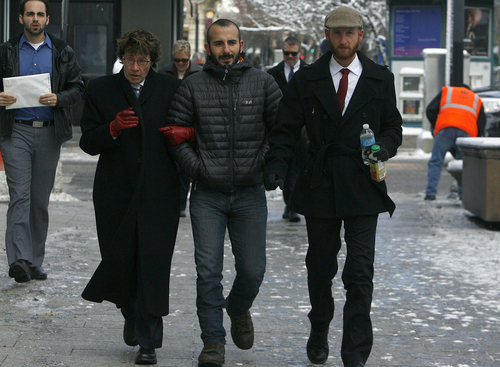 Scott Sommerdorf   |  The Salt Lake Tribune Moudi Sbeity, center, and Derek Kitchen, right, arrive with their attorney Peggy A. Tomsic at U.S. District Court Wednesday morning, Dec. 4, 2013.  Judge Robert J. Shelby ruled on Dec. 20 that Utah's ban on same-sex marriage is unconstitutional. The man on the right is unidentified. The woman at left is unidentified.