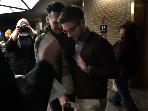 Leah Hogsten  |  The Salt Lake Tribune Jeffery Gomez, left, and James Goodman  react after being told that they are officially married in the lobby of the Salt Lake County offices, Friday December 20, 2013. Several hundred people descended on the Salt Lake County Clerk's Office Friday afternoon to get licenses. U.S. District Court Judge Robert J. Shelby in Utah Friday struck down the state's ban on same-sex marriage, saying the law violates the U.S. Constitution's guarantees of equal protection and due process.