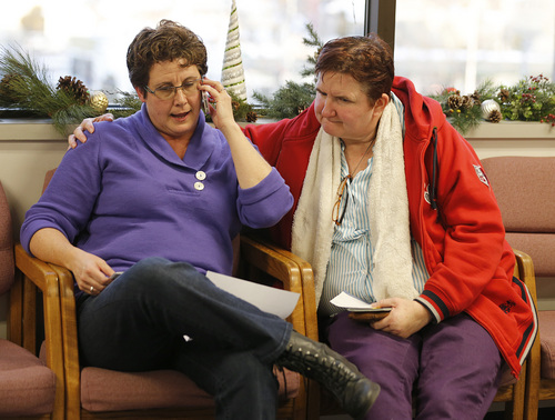 Terri Henry left, and Penny Kirby right, from Springville, Utah, look over a rejection letter for a marriage license in the offices of the Utah County Clerk and Auditor on Dec. 20, 2013 in Provo, Utah. A federal judge on Friday struck down Utah's ban on same sex marriage saying the law violates the U.S. Constitution.  (Photo by George Frey  |  Special to the Tribune)
