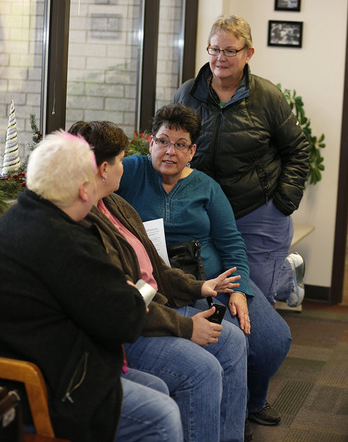 Raylynn Marvel left, Patsy Carter, 2nd left, from Orem, Utah, Loreen Major 2nd right, and Arlene Arnold right, from Lehi, Utah wait in the offices of the Utah County Clerk and Auditor office for word if they will be issued a marriage license as a lesbian couple on Dec. 20, 2013 in Provo, Utah. A Federal Judge on Friday struck down Utah's ban on same sex marriage saying the law violates the U.S. Constitution.  (Photo by George Frey  |  Special to the Tribune)