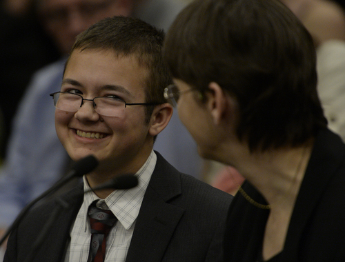 Rick Egan  | The Salt Lake Tribune   Grayson Moore smiles at his mother Neca Allgood  after telling their story at the first-ever open, public conversation between the LGBTQ community and Utah State Leaders, sponsored by Senators Steve Urquhart (R-St George) and Jim Dabakis (D-SLC) Wednesday, February 26, 2014.