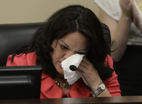 Rick Egan  | The Salt Lake Tribune   Sen. Luz Robles wipes a tear after an emotional speech at the first-ever open, public conversation between members of the  LGBT community and state lawmakers sponsored by Sens. Steve Urquhart, R-St. George and Jim Dabakis, D-Salt Lake Cityaway .