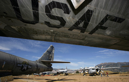 "Francisco Kjolseth  |  The Salt Lake Tribune People visiting the Hill Aerospace Museum on the edge of Hill Air Force Base near Ogden are dwarfed by some of the planes on display, including the wing of a Boeing WB-47E ""Stratojet"", the first swept wing multi-engine jet bomber, seen in this 2011 photo. The WB-47E is one of the planes the museum is eliminating to save money."
