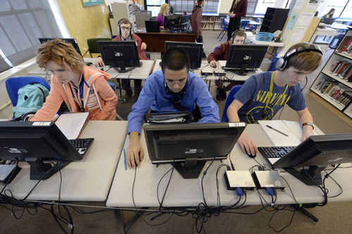 Francisco Kjolseth  |  The Salt Lake Tribune Rachel Lindsey, 15, Noah Hughes, 15, and Jaden Farr, 16, from left, learn Spanish on computers at DaVinci Academy as part of a blended ó online and classroom ó learning program. The Ogden charter school says it has hired more IT staff and made other changes in response to a state audit critical of online and distance learning programs offered by Utah schools.