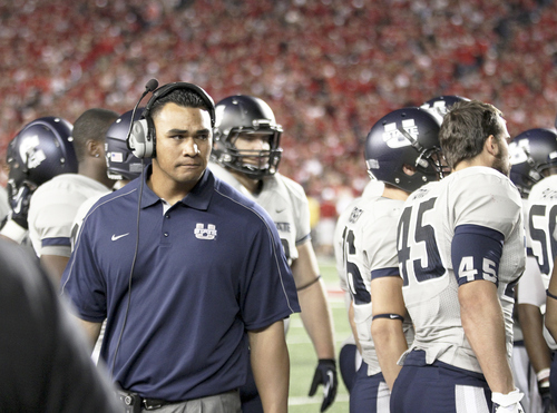 Photo courtesy of Josh Munns (mandatory credit)  Utah State defensive line coach Frank Maile on the sideline during Utah State's game against Wisconsin, September 15, 2012.
