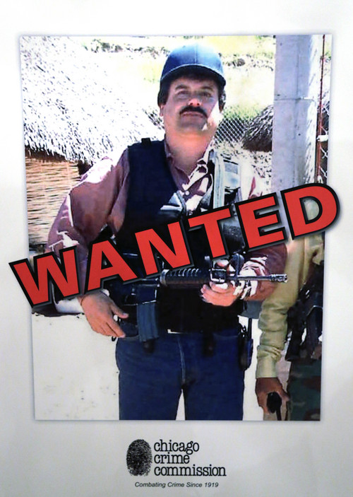 """ADVANCE FOR USE SUNDAY, MARCH 2 - FILE - This Feb. 14, 2013 image of a poster displayed at a Chicago Crime Commission news conference shows Joaquin """"El Chapo"""" Guzman, a drug kingpin in Mexico, who was deemed Chicago's Public Enemy No. 1. It was the first time since prohibition, when the label was created for Al Capone, that it was used to describe a criminal. Guzman, the one they called """"shorty"""" because of his 5'6"""" frame, a man who grew up poor and had no formal education, would rise from a small-time Mexican marijuana producer to lead the world's most powerful drug cartel.  (AP Photo/M. Spencer Green, File)"""
