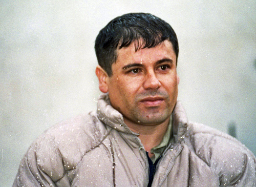 """ADVANCE FOR USE SUNDAY, MARCH 2 -FILE - In this June 10, 1993, file photo, Joaquin Guzman Loera, alias """"El Chapo"""" Guzman, is shown to the media after his arrest at the high security prison of Almoloya de Juarez, on the outskirts of Mexico City. Guzman, the one they called """"shorty"""" because of his 5'6"""" frame, was a man who grew up poor and had no formal education, would rise from a small-time Mexican marijuana producer to lead the world's most powerful drug cartel.  (AP Photo/Damian Dovarganes, File)"""