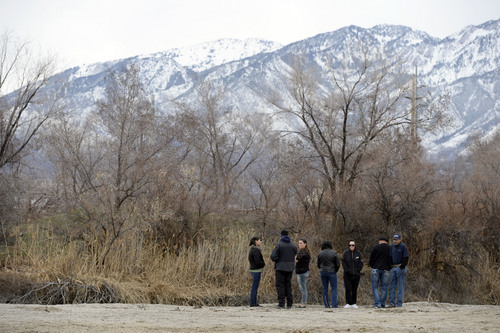 Francisco Kjolseth  |  The Salt Lake Tribune Salt Lake City police and family of Aletha Jo Williams who was 25 years old and 6 months pregnant when she was last seen March, 2002, gather along the banks of the Jordan River near 2590 S. 1160 East on Friday, Feb. 28, 2014. The Salt Lake City police department was acting on several credible tips that led them to reopen the case and focus on the river.