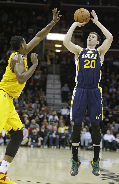 Utah Jazz's Gordon Hayward, right, shoots against Cleveland Cavaliers' Tristan Thompson, from Canada, during the second quarter of an NBA basketball game on Friday, Feb. 28, 2014, in Cleveland. Hayward scored 18 points for Utah. Cleveland defeated Utah 99-79. (AP Photo/Tony Dejak)