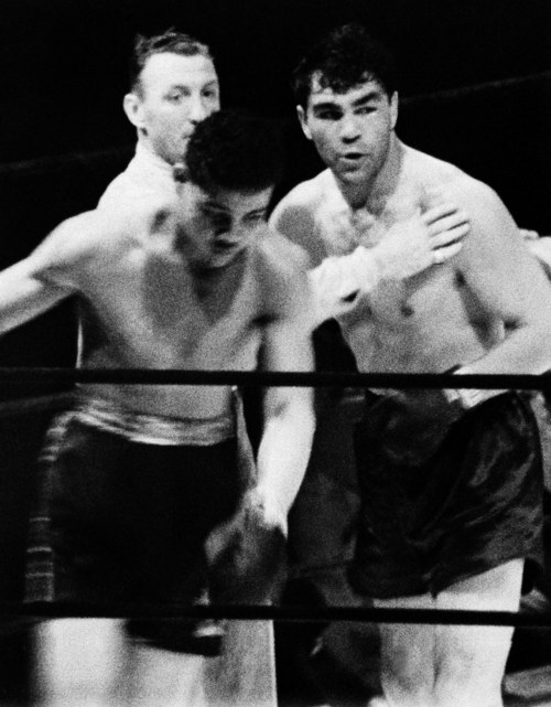 Referee Arthur Donovan had to hold Max Schmeling away from the dazed and staggering Joe Louis as the eighth round ended   June 19, 1936.     Schmeling had not heard the bell and was pressing for the kill when the picture was made.  This first fight between Louis and Schmellng took place at Yankee Stadium in New York.  Louis lost this fight in a knockdown.   (AP Photo)
