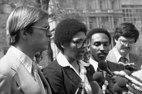 Three members of the U.S. Olympic Committee's Athlete Advisory Council face the press in Washington April 3, 1980 after they met with White House officials on the U.S. boycott of the summer Olympics in Moscow. Anita DeFrantz, center, said that a counter-proposal to compete in the Games but protest by refusing to participate in any ceremonies was rejected by the White House. From left are: Larry Hough, De Frantz and Fred Newhouse. (AP Photo/Mark Wilson)