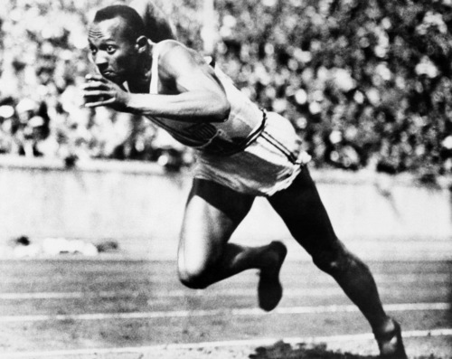 FILE -- In this Aug. 14, 1936, file photo, Jesse Owens competes in one of the heats of the 200-meter run at the 1936 Olympic Games in Berlin. One of the four Olympic gold medals won by Owens at the 1936 Berlin Games is for sale in an online auction that runs from through Dec. 7. (AP Photo/File)
