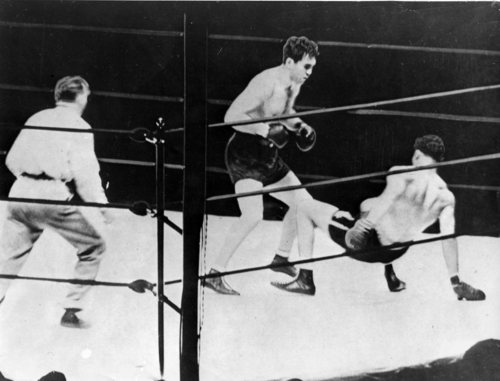 The scene during the 4th round showing Joe Louis on the ground after Max Schmeling had scored a right and slammed Louis to the floor. (AP-Photo)