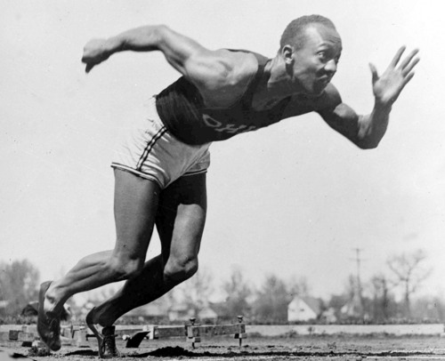 American athlete Jesse Owens practices in the Olympic Village, in Berlin, Germany, Aug. 5, 1936. (AP Photo)