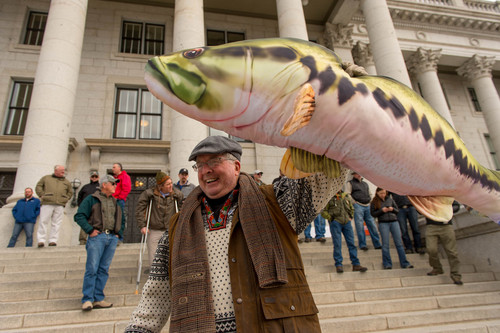 Trent Nelson  |  The Salt Lake Tribune Bill Shorter holds up a stuffed fish as anglers gather earlier this month on the south steps of the Capitol in Salt Lake City in support of Rep. Dixon Pitcher's HB37, which would restore open access to Utah's waterways.