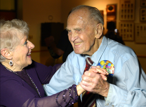 Rick Egan  | The Salt Lake Tribune   Karl Tinggaard dances with Margie Ross, as he celebrates his 100th birthday at the Heritage Center in Murray on Thursday, February 27, 2014.