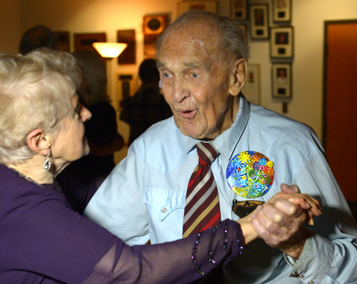 Rick Egan  | The Salt Lake Tribune   Karl Tinggaard dances with Margie Ross, as he celebrates his 100th birthday  at the Heritage Center in Murray on Thursday, Feb. 27, 2014. Tinggaard is a regular at the center's Thursday night dances.