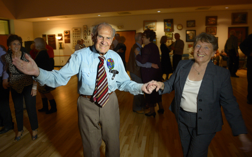 Rick Egan  | The Salt Lake Tribune   Karl Tinggaard dances with Barbara Eaton at his 100th birthday party at the Heritage Center in Murray on Thursday, February 27, 2014.