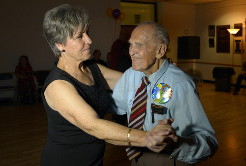 Rick Egan  | The Salt Lake Tribune   Karl Tinggaard dances with Sondra Montoya, as he celebrates his 100th birthday dancing at the Heritage Center in Murray, like he does every Thursday, on Thursday, February 27, 2014.