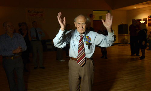 Rick Egan  | The Salt Lake Tribune   Karl Tinggaard recognizes the crowd as they clap for him as he celebrates his 100h birthday, dancing at the Heritage Center in Murray, as he does every Thursday, on Thursday, February 27, 2014.