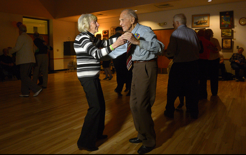 Rick Egan  | The Salt Lake Tribune   Karl Tinggaard dances with Shirley Maynard at his 100th birthday party at the Heritage Center in Murray on Thursday, February 27, 2014.