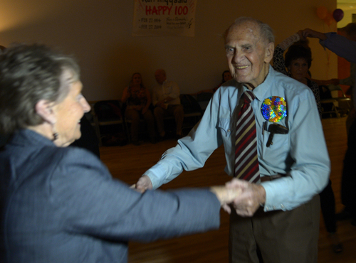 Rick Egan  | The Salt Lake Tribune   Karl Tinggaard dances with Barbara Eaton, as he celebrates his 100th birthday dancing at the Heritage Center in Murray, like he does every Thursday, on Thursday, February 27, 2014.
