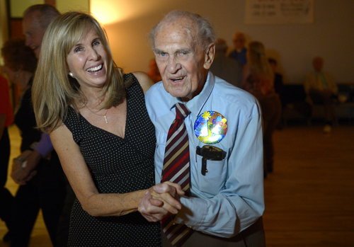 Rick Egan  | The Salt Lake Tribune   Karl Tinggaard celebrates his 100th birthday as he dances  at the Heritage Center in Murray,as he does every week, on Thursday, February 27, 2014.