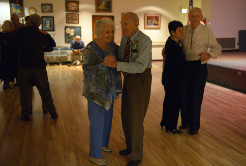 Rick Egan  | The Salt Lake Tribune   Karl Tinggaard dances with Venus Cederstrom, as he celebrates his 100th birthday dancing at the Heritage Center in Murray on Thursday, February 27, 2014. Tinggaard is a regular at the center's Thursday night dances.