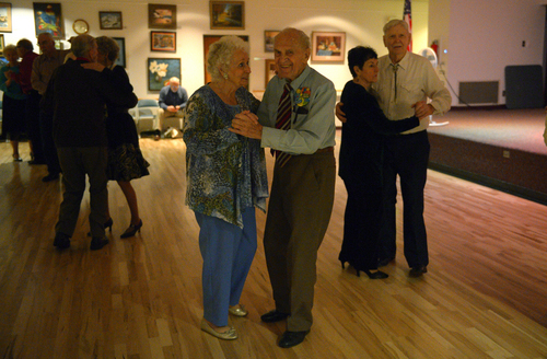 Rick Egan  | The Salt Lake Tribune   Karl Tinggaard dances with Venus Cederstrom, as he celebrates his 100th birthday dancing at the Heritage Center in Murray, like he does every Thursday, on Thursday, February 27, 2014.