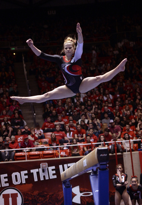 Al Hartmann  |  The Salt Lake Tribune  University of Utah's Tory Wilson gets high altitude over the beam during her routine in a gymnastics meet against the University of Washington at the Huntsman Center Friday February 28.