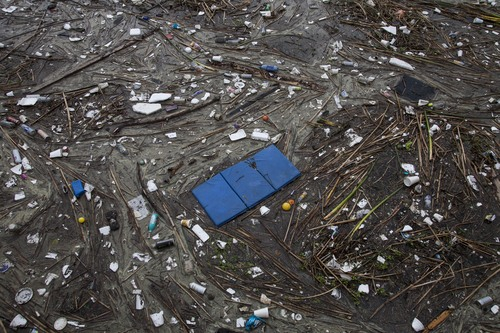 Trash collects along the shore after after a rainstorm in Long Beach, Calif. on Saturday, March 1, 2014. (AP Photo/Ringo H.W. Chiu)