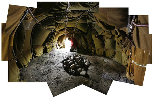 Francisco Kjolseth  |  Tribune file photo Photo composite of the inside of the sweat lodge erected at the VA Hospital in Salt Lake, medicine man, Arnold Thomas who is completely blind feels around for debris in preperation for a ceremonial sweat. The buffalo style sweat lodge, built to represent the rib cage of a buffalo, is meant to transcend participants to birth and the womb and being born out of darkness.