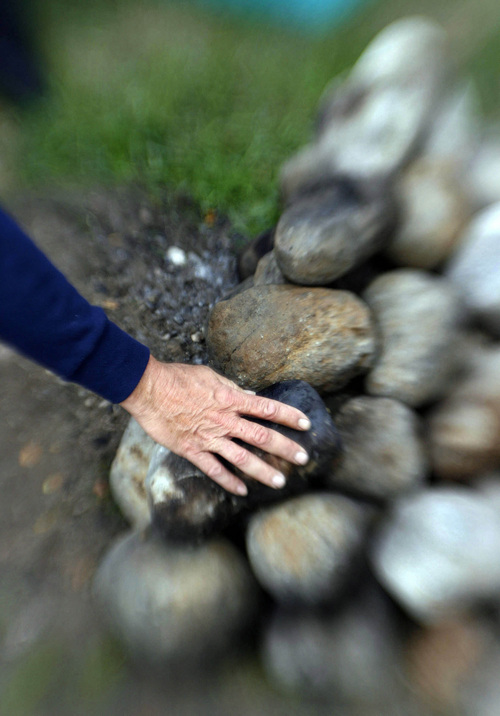 A volunteer and recovering drug addict at the VA Hopsital pulls cold stones from the sweat lodge erected in one of the hospital's court yards prior to another ceremonial sweat on Oct. 19, 2006.    Photo by Francisco Kjolseth/The Salt Lake Tribune