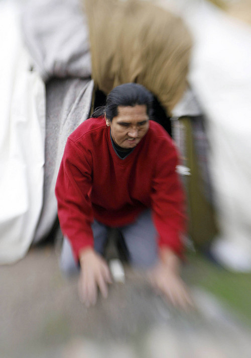 Medicine Man Arnold Thomas, who is blind, uses his hands to prepare the altar in front of the opening to the sweat lodge prior to the start of the ceremony on Oct. 19, 2006.  Photo by Francisco Kjolseth/The Salt Lake Tribune