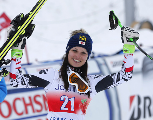 Austria's Anna Fenninger celebrates at the finish area after taking second place in an alpine ski, World Cup women's downhill, in Crans Montana, Switzerland, Sunday, March 2, 2014. (AP Photo/Marco Trovati)