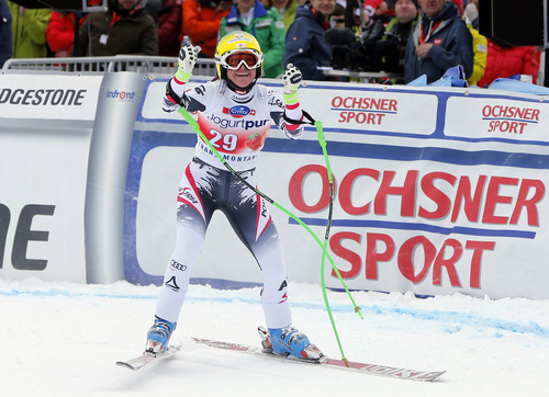 Austria's Andrea Fischbacher celebrates at the finish line after winning an alpine ski, World Cup women's downhill, in Crans Montana, Switzerland, Sunday, March 2, 2014. (AP Photo/Marco Trovati)
