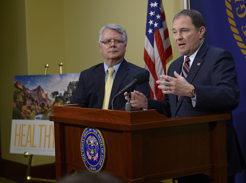 Scott Sommerdorf   |  The Salt Lake Tribune Utah Governor Gary Herbert, along with Dr. W. David Patton, of the Utah Department of Health, at left, announced that he will choose to reject full medicaid expansion, and instead seeks a block grant to help cover poorest Utahns, Thursday, Feb. 27, 2014.
