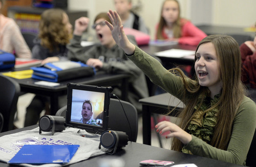 Francisco Kjolseth  |  The Salt Lake Tribune Meghan Hawkesworth, 12, answers a science question in class while sitting next to classmate, Andrew Gardner on screen. Gardner nearly drowned as a child, permanently damaging his lungs. To avoid Utah'spollution-trapping inversions he spends much of the winter ine Arizona with his grandparents.