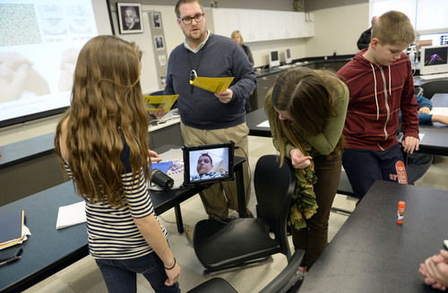 """Francisco Kjolseth     The Salt Lake Tribune Andrew Gardner contributes to a group science project at Albion Middle School via """"Facetime."""" The 12-year-old Sandy boy nearly drowned on a rafting trip three summers ago, permanently damaging his lungs. To escape Utah's winter pollution the 7th-grader takes temporary refuge in Arizona."""